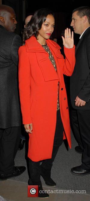 Zoe Saldana, Red Coat, Wave and Hand Gesture