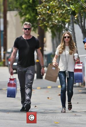 Eric Dane and Rebecca Gayheart - Eric Dane and Rebecca Gayheart leaving Fred Segal after shopping together - Los Angeles,...