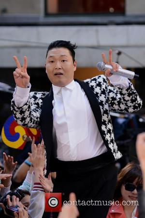 Radio Ga-Gangnam: Psy And Queen's Brian May To Collaborate?