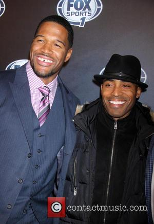 Michael Strahan and Guest - 2013 Fox Sports Media Group Upfront After Party - Arrivals - New York City, NY,...