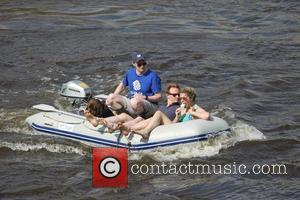 People Boating In Richmond and Atmosphere