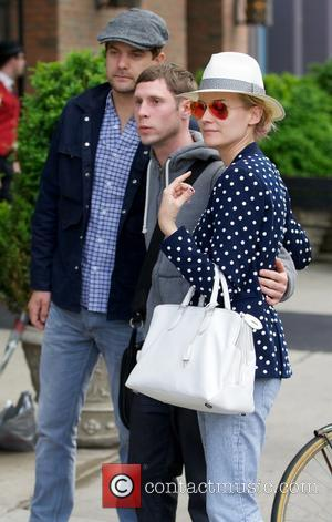 Joshua Jackson and Diane Kruger - Joshua Jackson and Diane Kruger seen posing with a fan in the East Village....