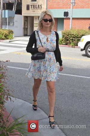 Holly Madison - Holly Madison wears a summery dress while strolling through Beverly Hills - Los Angeles, CA, United States...
