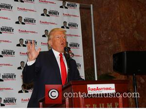 Donald Trump - Donald Trump distributes free money at the launch of FundAnything.com at Trump Plaza. - New York, NY,...