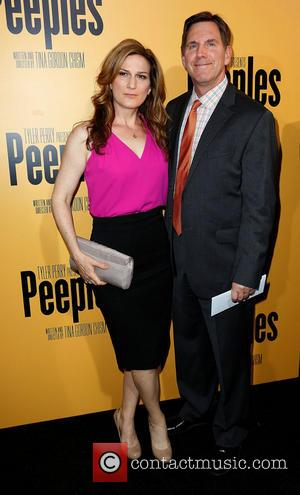 Ana Gasteyer and Guest - Premiere of 'Peeples' presented by Lionsgate Film and Tyler Perry at ArcLight Hollywood - Los...