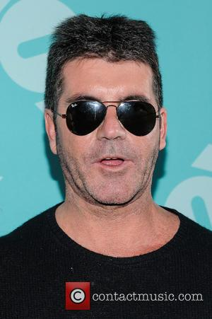 Can You Smell Egg? Simon Cowell Gets Pelted Mid-BGT Final [Video]