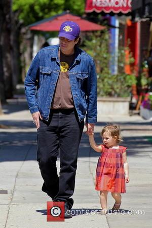 Benicio del Toro and Delilah del Toro - Benicio del Toro takes his daughter Delilah del Toro for a walk...