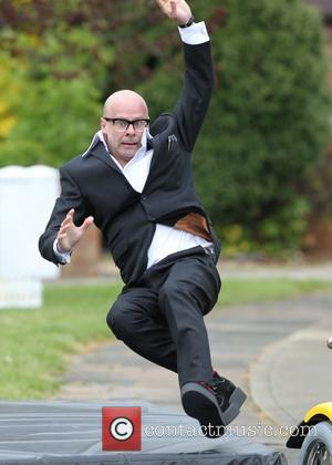 Harry Hill and Julie Walters Race Scooters For 'The Harry Hill Movie' [Pictures]