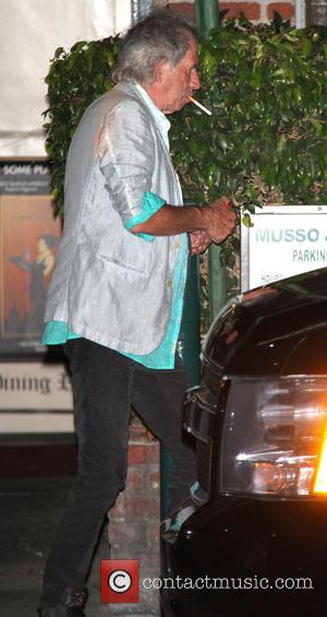 Keith Richards - Keith Richards smokes a cigarette outside Musso & Frank Grill in Hollywood - Los Angeles, California, United...