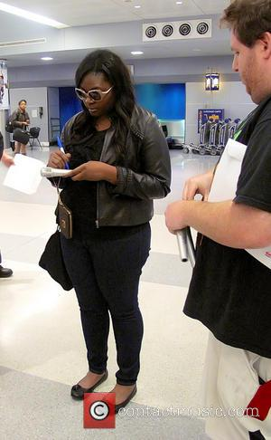 Candice Glover - Candice Glover, the new winner of 'American Idol' season 12, signs autographs after arriving at John F....