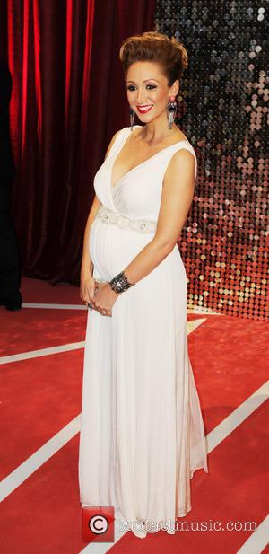 Lucy Jo Hudson and Husband Alan Halsall - The British Soap Awards 2013 - Arrivals - Manchester, United States -...
