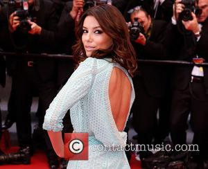 Eva Longoria Suffers Wardrobe Malfunction In Cannes