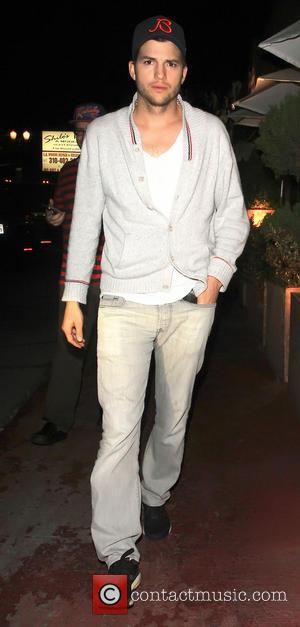 Ashton Kutcher - Ashton Kutcher leaving Shilohs restaurant with Yehuda Berg who is the head of the Kabbalah Centre -...