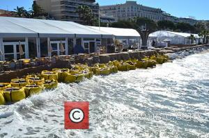Organisers of the 66th Cannes Film Festival have placed large sandbags by the Carlton Pier and on Nikki Beach to...