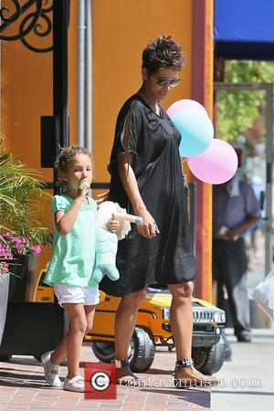 Halle Berry and Nahla Aubry - A pregnant Halle Berry and her daughter Nahla seen shopping at Bel Bambini for...
