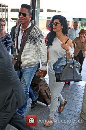 Jermaine Jackson and Halima Rashid - Celebrities arriving at LAX Airport - Los Angeles, CA, United States - Monday 20th...