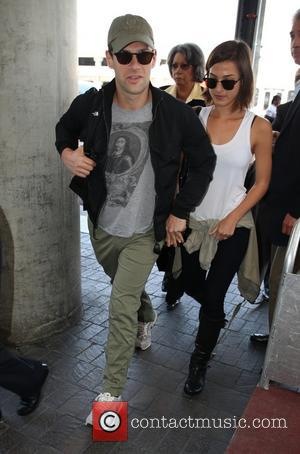 Justin Bartha and Lia Smith - Celebrities arriving at LAX Airport - Los Angeles, CA, United States - Tuesday 21st...