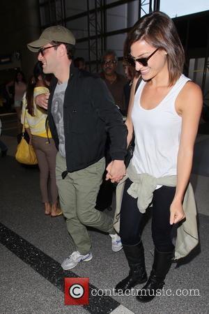 Justin Bartha and Mia Smith