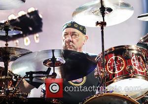Neil Peart - Rush Performing on the first night of Their 'Clockwork Angels' UK Tour at Manchester Arena - Manchester,...