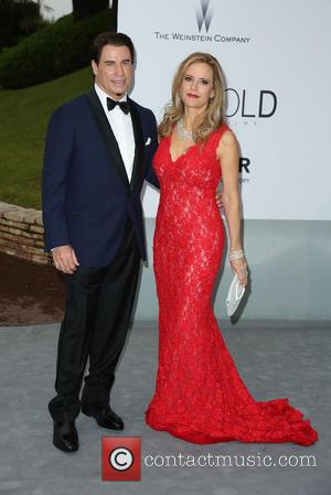 John Travolta and Kelly Preston - amfAR 21st Annual Cinema Against AIDS during the 67th Cannes Film Festival at Hotel...