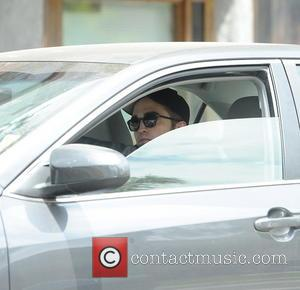 Robert Pattinson - Robert Pattinson drives himself to a meeting...