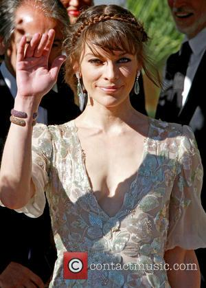 Milla Jovovich Cheers Up Husband With Nude Photos
