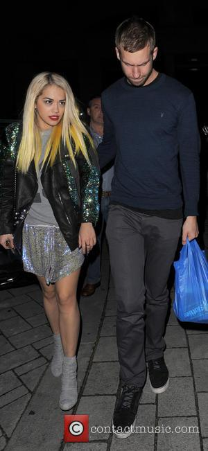 Rita Ora and Calvin Harris - Rita Ora and Calvin Harris arriving home with some snacks including a large bag...