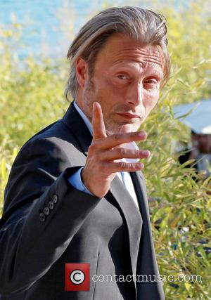 Mads Mikkelsen - Mads Mikkelsen arrives to appear on the 'Le Grand Journal' television show in Cannes during the 66th...