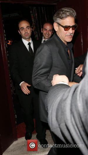 George Clooney - George Clooney leaving Loulou's mightclub in Mayfair in London. Soon after George left two women were seen...
