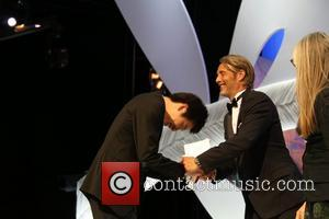 Mads Mikkelsen and Moon Byung-Gon - 66th Cannes Film Festival - Inside Closing Ceremony - Cannes, France - Sunday 26th...