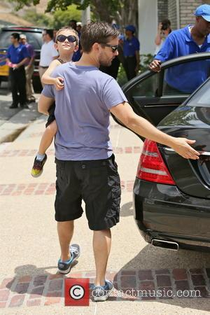 Toby Maguire and Otis Maguire - Toby Maguire and his son, Otis arriving at Joel Silver's Memorial Day Party at...