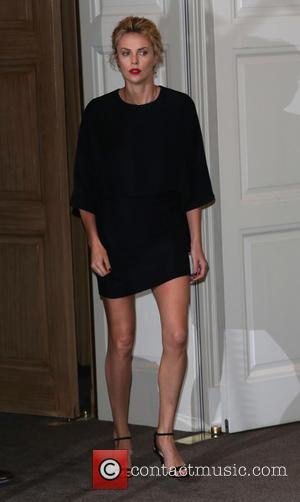 Charlize Theron - 'A Million Ways to Die in the West' photocall at Claridge's hotel - London, United Kingdom -...