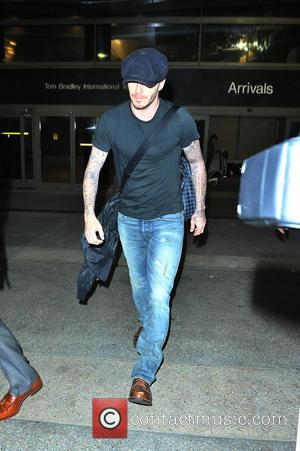 David Beckham - David Beckham At LAX