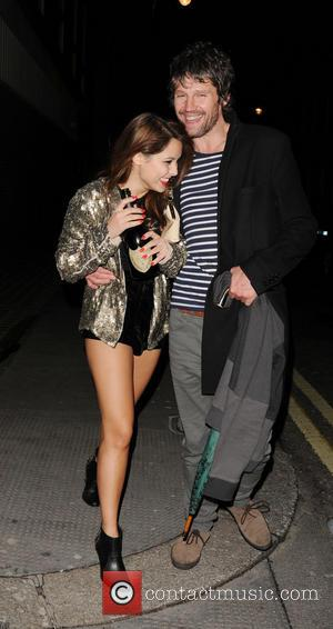 Jason Orange - Take That singer Jason Orange leaving Whisky Mist club with a female companion carrying a 130 GBP...