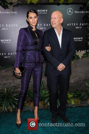 Bruce Willis and Emma Heming - New York premiere of 'After Earth' held at the Ziegfeld Theatre - New York...