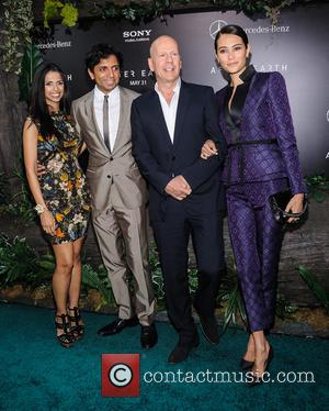 M Night Shyamalan, Bruce Willis and Emma Heming - New York premiere of 'After Earth' held at the Ziegfeld Theatre...