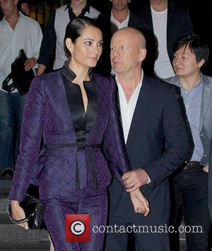 Bruce Willis and Emma Heming - New York premiere of 'After Earth' held at the Ziegfeld Theatre - Departures -...