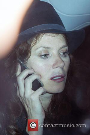 Anna Friel - Anna Friel leaving The Groucho Club. She was carrying a bag with a bottle of wine inside...