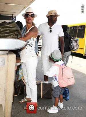 Bobby Brown, Alicia Etheredge and Cassius Brown - Bobby Brown arrives at LAX airport with his wife and their son...