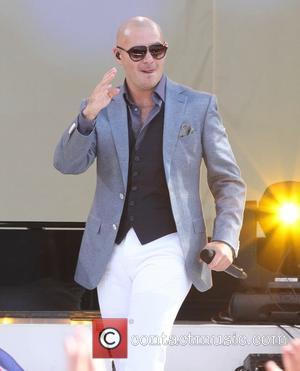 Pitbull and Armando Perez - Pitbull performs live on ABC's 'Good Morning America' at Rumsey Playfield in Central Park -...