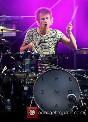 Dominic Howard and Muse - Muse performs live on their 'The 2nd Law World Tour' at Etihad Stadium - Manchester,...