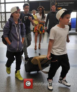 Romeo Beckham and Cruz Beckham - Victoria Beckham arrives at LAX airport with her children - Los Angeles, California, United...