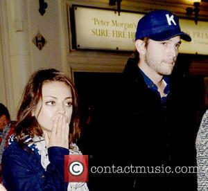 Ashton Kutcher and Mila Kunis - Ashton Kutcher and Mila Kunis leave The Apollo Theatre after watching the play 'The...