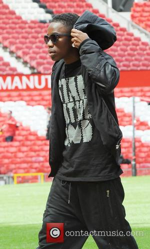 Tinchy Stryder - Tinchy Stryder arrives at Old Trafford stadium for the Charity Match between Manchester United vs. Real Madrid...