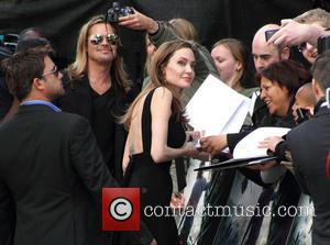 Angelina Jolie Makes First Post-double Mastectomy Appearance At World War Z Premiere [Photos]