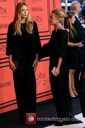 Elizabeth Olsen and Mary Kate Olsen - 2013 CFDA Awards - arrivals - Manhattan, NY, United States - Tuesday 4th...