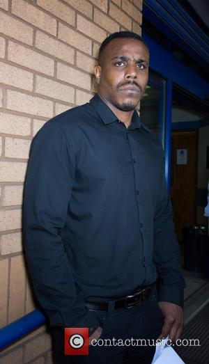 Mike GLC - Mike GLC outside Belgravia Police station. He was arrested and bailed along with X Factor Judge Tulisa...