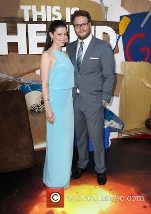 Lauren Miller and Seth Rogen - Los Angeles premiere of 'This Is The End' held at the Regency Village Theatre...