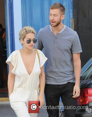 Calvin Harris and Rita Ora - Calvin Harris and Rita Ora emerge from a private residence and head to a...