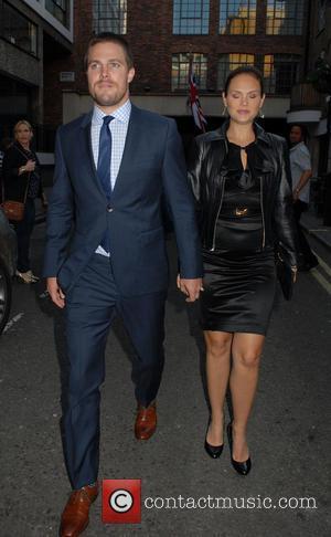 Stephen Amell and Cassandra Jean - Stephen Amell and Cassandra Jean out and about in Soho - London, United Kingdom...